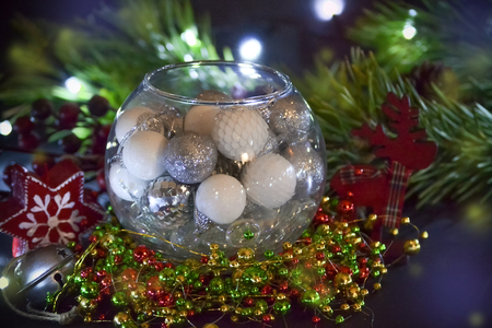 New Year card. Christmas decorations in the glass sphere. Congratulations on the holiday.