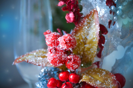 Christmas decorative composition of red berries in the snow with imitation of ice crystals.