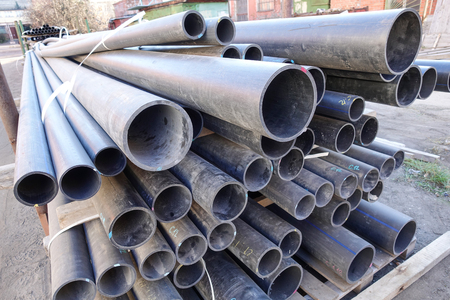 Old plastic pipes of various sizes and diameters