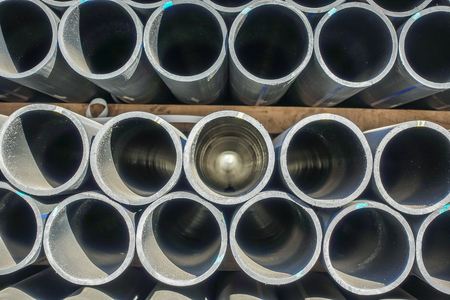 Plastic pipes in stock of finished products stacked in packs