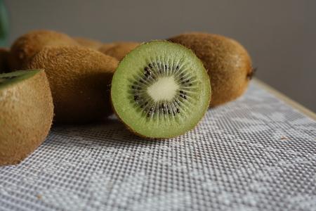 Fresh kiwi fruit on the table. Whole and cut