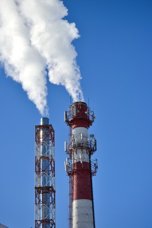 Two pipes. Industrial smoke from a chimney against the sky Stock Photo