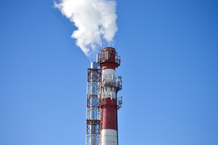 Two pipes. Industrial smoke from a chimney against the sky Standard-Bild - 119655260