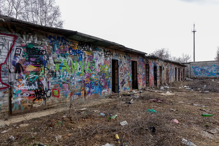 Destroyed brick buildings painted with graffiti. Russian favella. Moscow region. Stock Photo