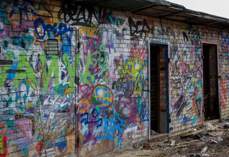Destroyed brick buildings painted with graffiti. Russian favella. Moscow region. Stok Fotoğraf