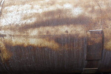 Rusting iron tank. Abstract industrial background