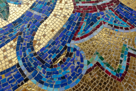 Mosaic fragment. Floral ornament blue on a golden background.