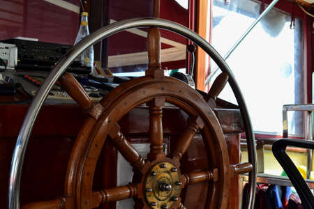Wood steering wheel of a cruise ship. Close-up.