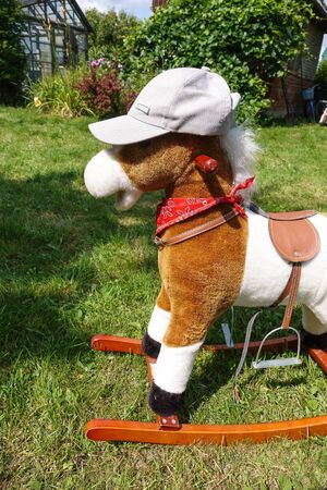 Toy children's horse for a child. Horse in a cap.