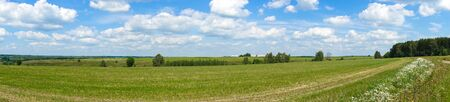 Panorama. Beautiful landscape. Green field with clouds. Russia Stock Photo