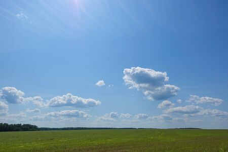Blue blue sky with clouds. Beautiful countryside landscape.