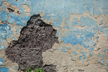 Old plaster is crumbling from the wall. urban background grunge wall texture