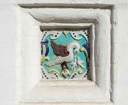 Image of a bird on ceramic tile. Ancient decoration of the ancient orthodox church.