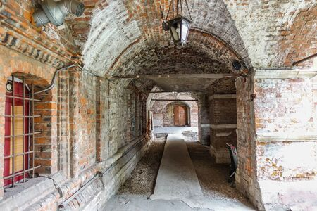 Antique collapsing interior with arches and arches