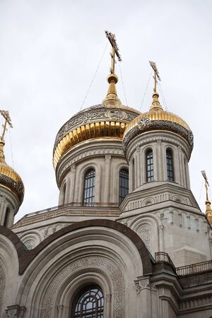 Eastern orthodox crosses on domes, cupolas, fog and cloudy weather.