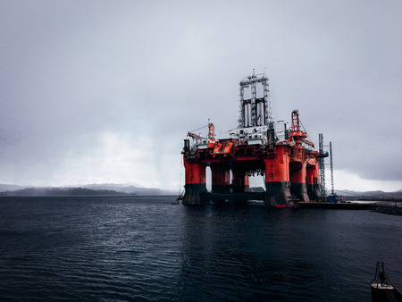 Massive red and blue oil rig in Norway fjords Stock Photo
