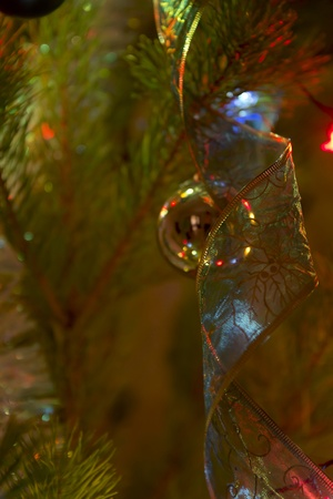 Gold sphere on christmas tree photo