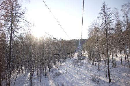 chairlift: chairlift over winter forest
