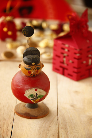 auspicious: The Red Auspicious Chinese Doll of Chinese New Year.