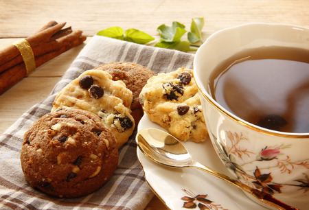 Cookies and Tea are on Wooden Background for Breaking Time.
