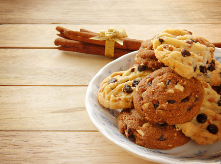 Cookies and Tea are on Wooden Background for Breaking Time. photo