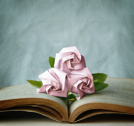 Valentine Abstract with Three Pink Roses are on Vintage Book. Still Life and Vintage Style. Valentine photo