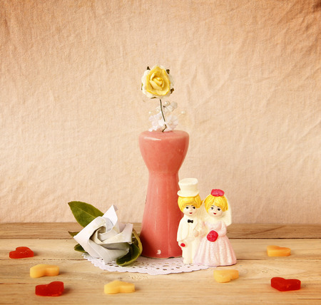 tableau: Valentine Abstract with Souvenir Wedding are on wooden background. Valentines Day.