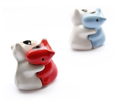 mate married: Hugging ceramic dolls on white background. Stock Photo