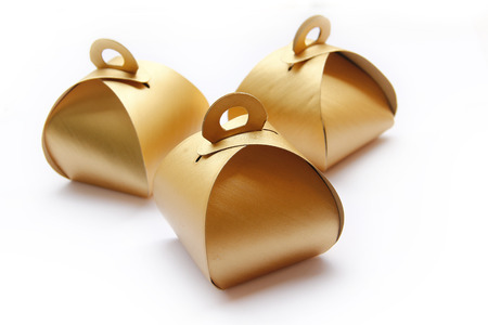 Three Golden Package Boxes are on White Background. photo