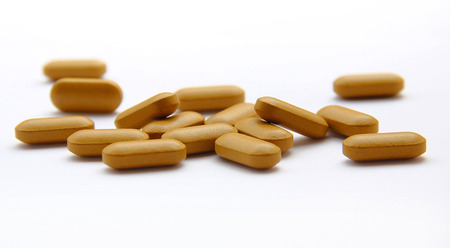 multivitamin: supplementary food isolated on the white background