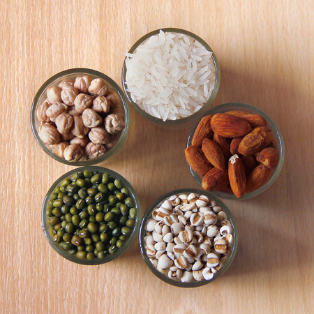 Different kinds of Grains, lentil, peas in dish on wooden table photo