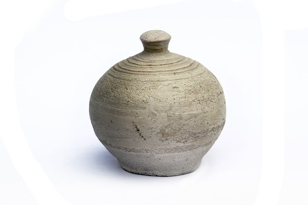 an unglazed earthenware bottle: Vintage Pottery isolated over a white background.