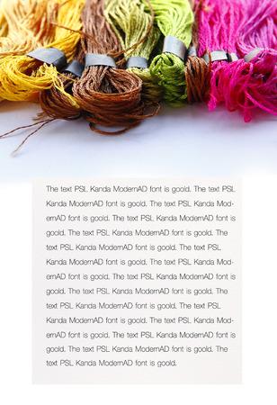 silk thread: Colorful raw silk thread background with copy space.