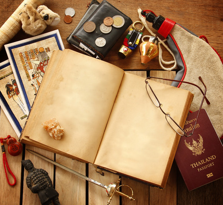 vintage travel: Preparing for travel,reservation ticket close-up with copy space vintage book