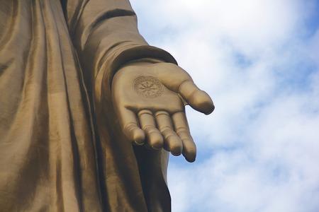 gautama: The Hand of Giant Bronze Chinese Buddha Statue.