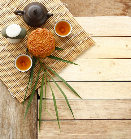 Mooncake, Chinese mid autumn festival food on Wooden Background. Dessert Concept.