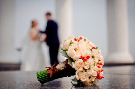 lowers: Couple dancing on the background of a beautiful bouquet. Stock Photo