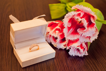 ornamentations: Ring in a box and a bouquet of flowers. Stock Photo