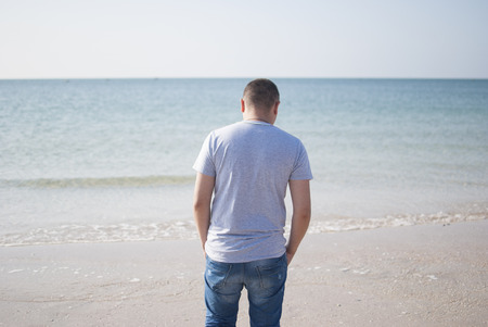 ennui: Lonely sad man in the sea.