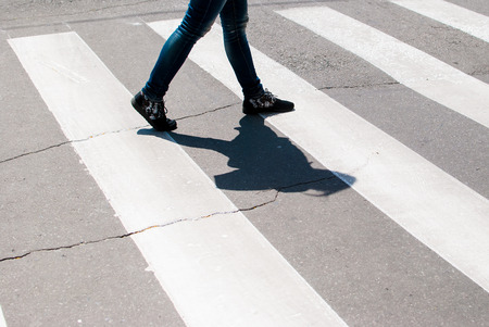 enters: Man enters the crosswalk on the road. Traffic rules