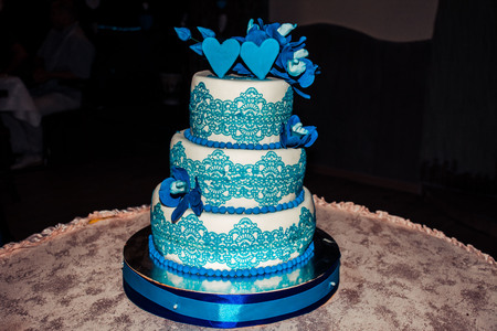 three-tier wedding cake with a blue border