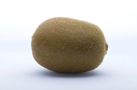 Whole kiwi fruit isolated on white background