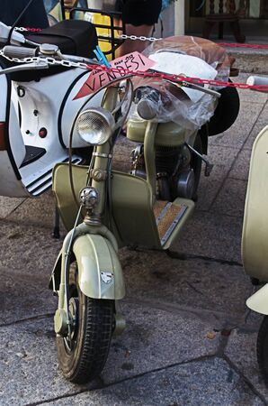 Old scooter for sale on a mediterranean street