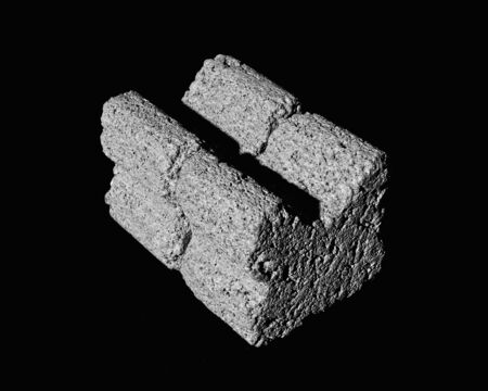 grey concrete spacers isolated on black background. Black and white. High contrast. 스톡 콘텐츠