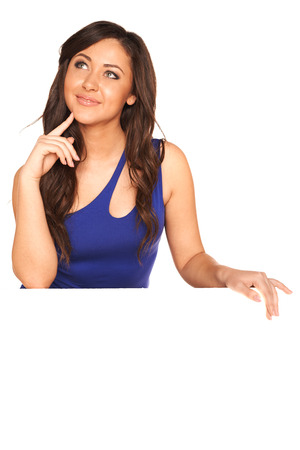 Girl in blue dress behind white wall photo