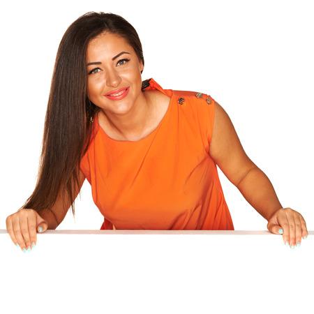 Girl in orange dress behind white board photo
