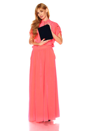 Girl in pink dress with tablet computer photo