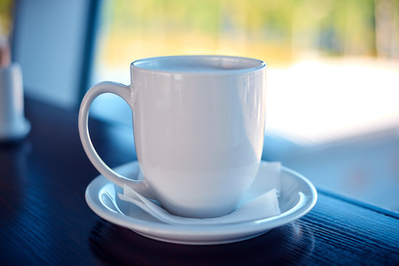 airport window: White coffee cup on a airport window background Stock Photo