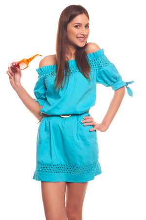 skintight: Pretty girl in blue dress with glasses isolate on white background