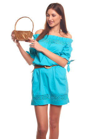 Pretty girl in blue dress with basket isolate on white background Stock Photo